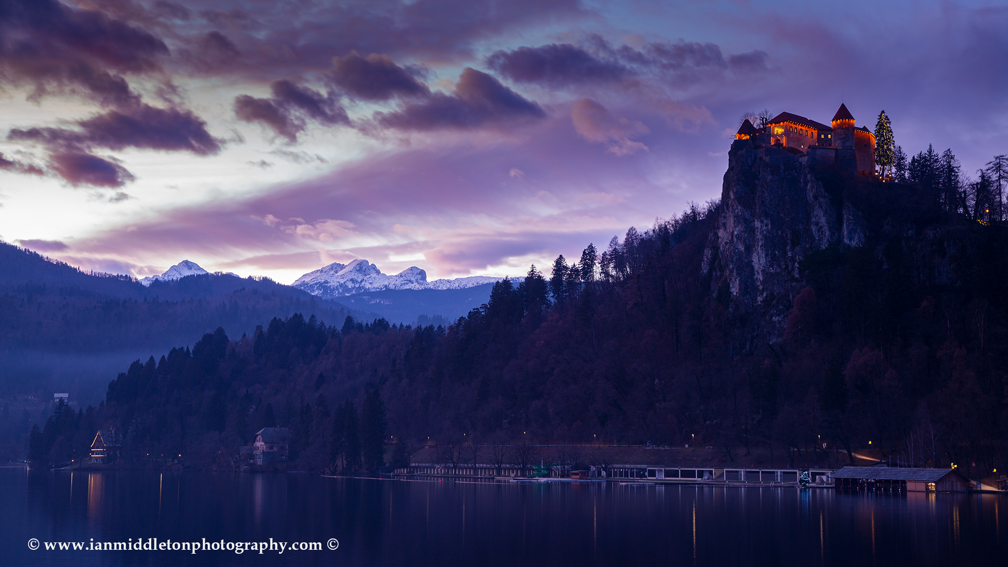 Sunset over the castle and Julian Alps