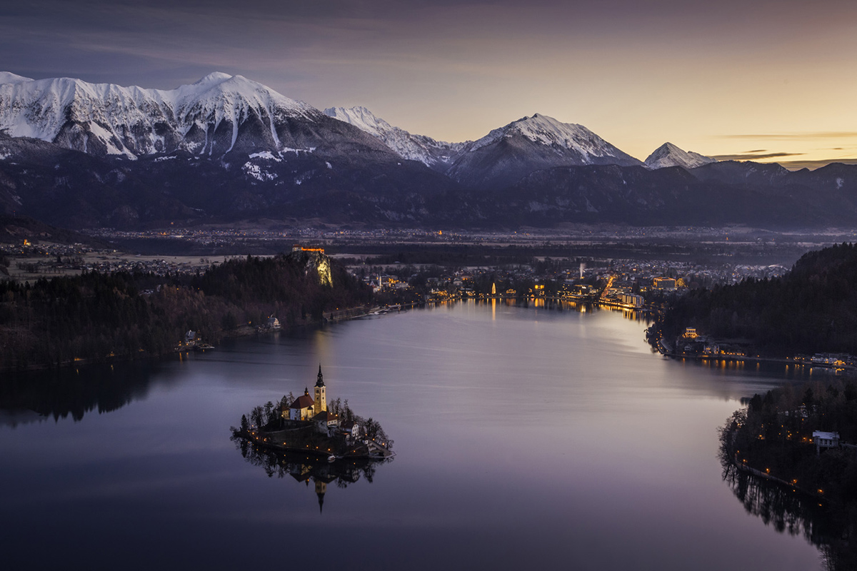 The icon Lake Bled with its island church and clifftop castle backed by the stunning Karavanke Mountains. A popular place on our photography workshops.